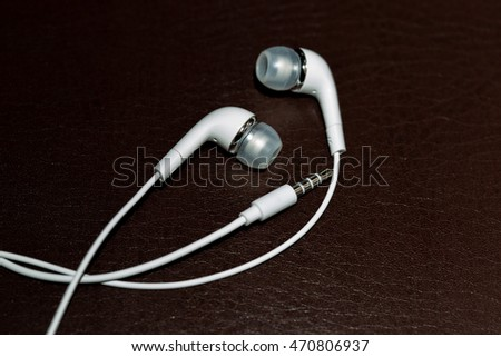 White headphones on a dark background macro