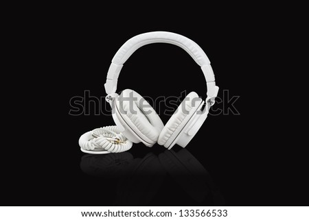 White headphones on black background