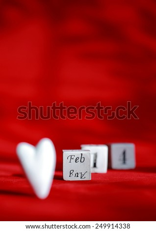 "White heart and Three cubes with "" feb. 14 "" words on red background. Wallpaper for valentine's day."