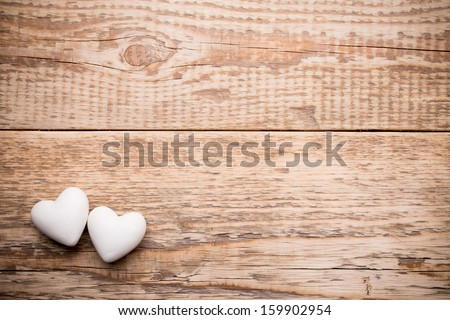 White heart and wooden  background. - stock photo