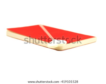 White heart on the open red book isolated on white background, select focus.  - stock photo