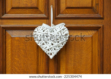 White Heart on wooden Background - Door with Decoration - stock photo