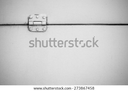 white hinge on withe metal background