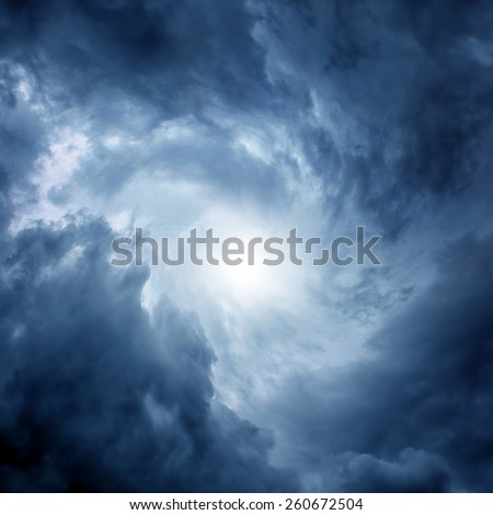 White Hole in the Whirlwind of dark storm clouds - stock photo