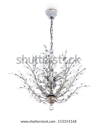 White home interior - Crystal chandelier with hanging crystals. Closeup of glass and metalworked lamp. - stock photo