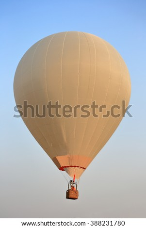 White hot air balloon on sky - stock photo