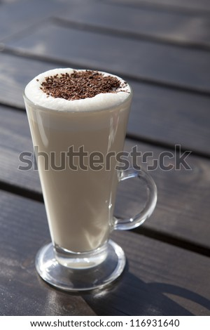 White hot chocolate cup with chocolate on top