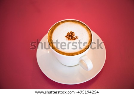 White hot coffee cup on pink background