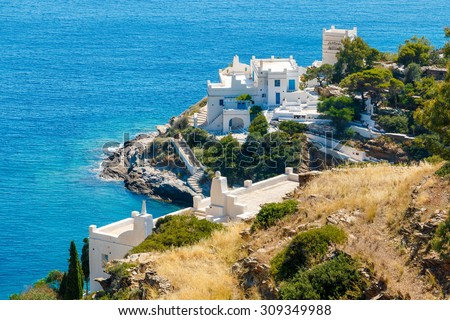 White hotels on the blue sea side on Ios island, Greece - stock photo