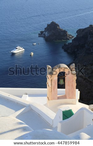 White house and and bell tower in Oia. Santorini - stock photo