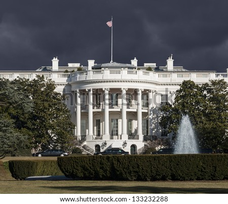 White House with storm sky in Washington DC. - stock photo