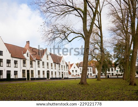White houses in the Beguinage (Begijnhof) in Bruges, Belgium   - stock photo