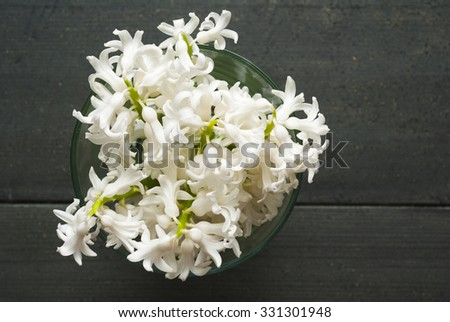 white hyacinth bouquet on black wooden table