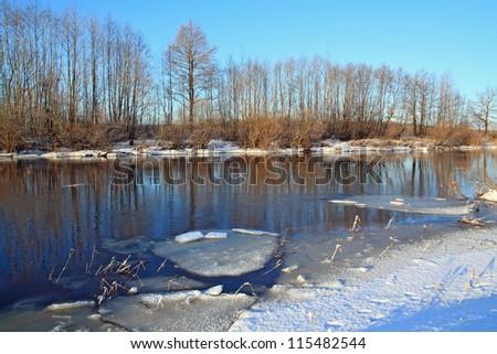 white ice on autumn river - stock photo
