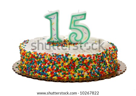 White iced sprinkle covered anniversary or birthday cake with number 15 candles on it. - stock photo