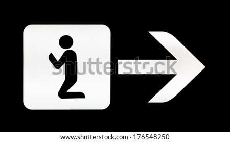 White illuminated sign with direction for prayer room on airport - stock photo