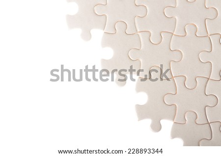 white incomplete jigsaw puzzle closeup concept of failure completing task under construction - stock photo
