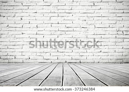 White inside interior of industrial room with wooden floor and brick wall - stock photo