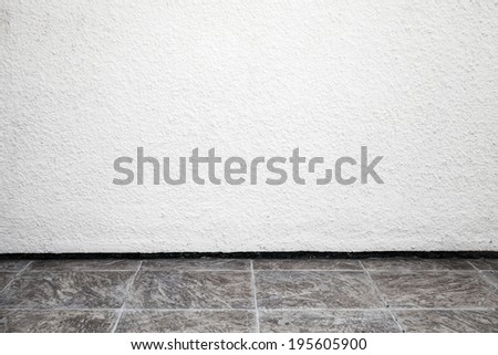 White interior background with rough stucco wall and tiling floor - stock photo