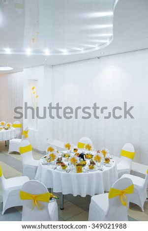 white interior of the restaurant. white interior with yellow napkins, sunny decor cafe