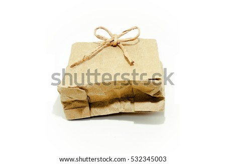 white isolated of empty wrinkled brown paper parcel decorated with bow