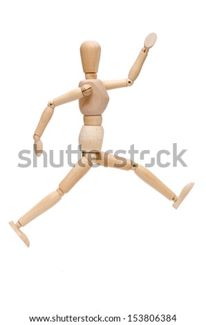White isolated wooden figure in a leap