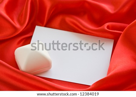 White jewerly  box and empty card on red satin - stock photo
