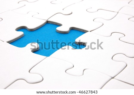 white jigsaw or puzzle background with copyspace