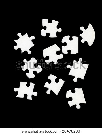 White jigsaw pieces on black background