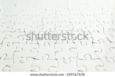 White jigsaw puzzle background - stock photo