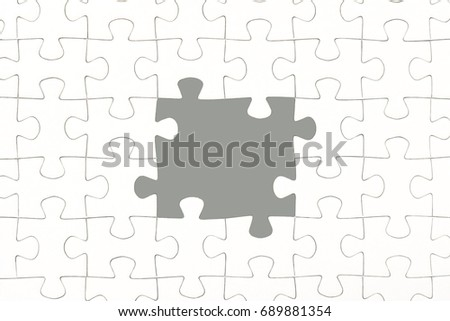 White jigsaw puzzle pieces background, center of white jigsaw puzzle piece missing