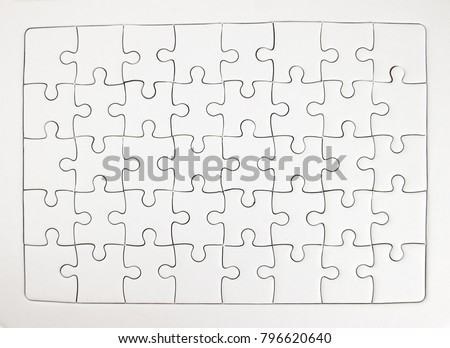 White jigsaw puzzle pieces completed as copy space.