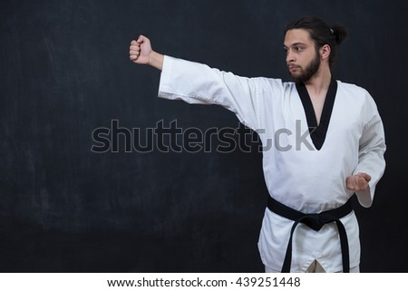 White Karate Fighter Isolated On Black With Copyspace