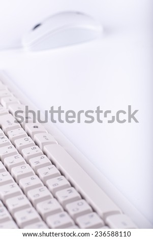 white keyboard and mouse close up on white background