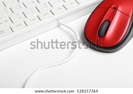 White keyboard and red mouse - stock photo