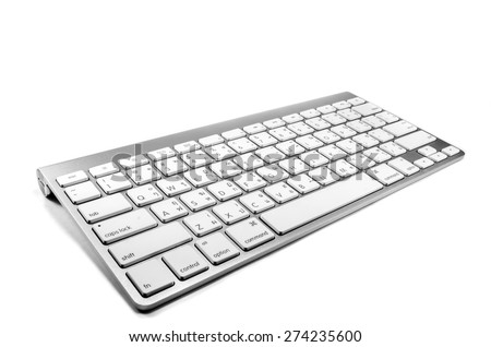 White keyboard mounted on silver against white