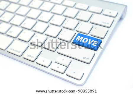 white keyboard with move button
