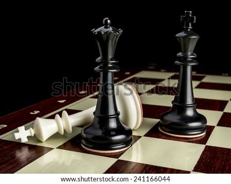 White King checkmated by black Queen with Black King on chessboard - stock photo
