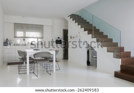 White Kitchen And Dining Room With Epoxy Floor Wooden Stairs