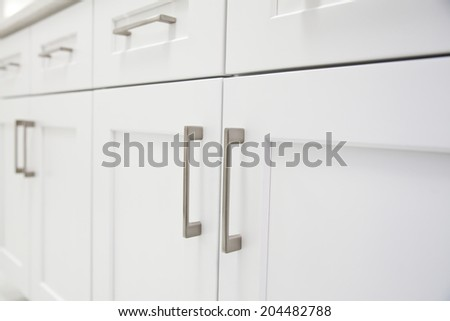 White kitchen cabinet in kitchen - stock photo