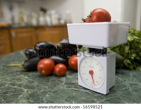 white kitchen scale and vegetable cucumber and tomato - stock photo