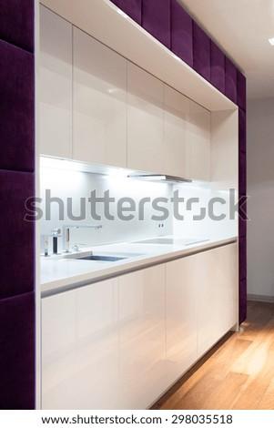 White kitchen unit in luxury detached house - stock photo