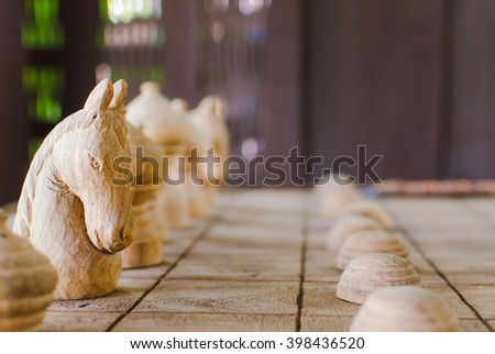 white knight chess team on the wood board background. - stock photo