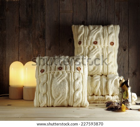 white knitted pillow pattern - stock photo