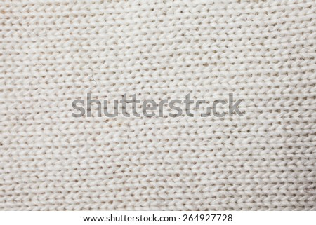 White knitted woolen fabric background or texture - stock photo