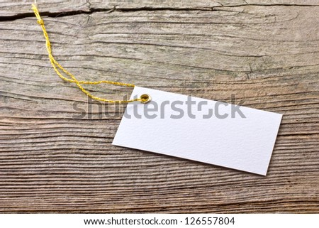 White label on wooden ground/label/white