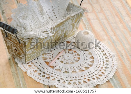 white lace in vintage basket on a wooden table