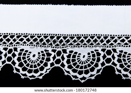 white lace isolated on black