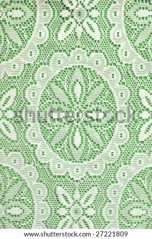 White lace on green background - stock photo