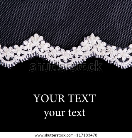 White lace on the black background - stock photo